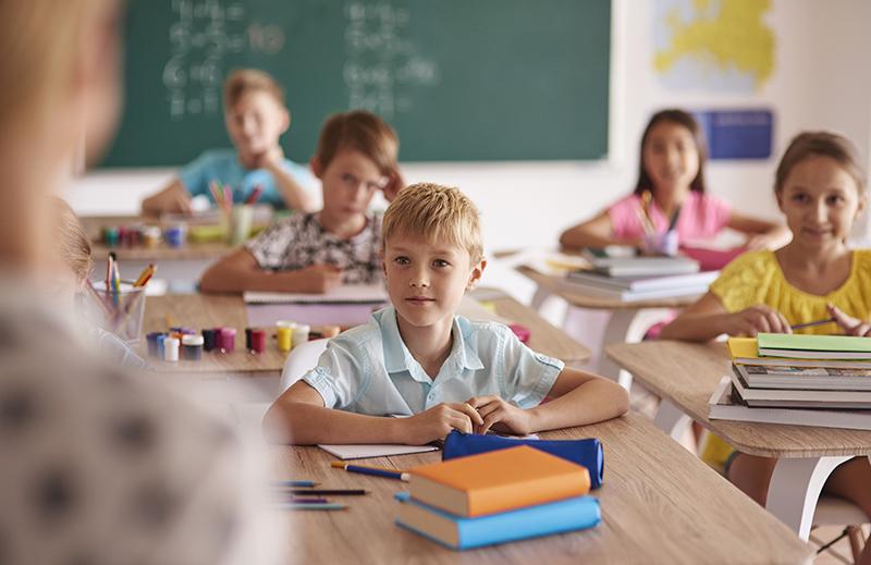 school children sitting at desks